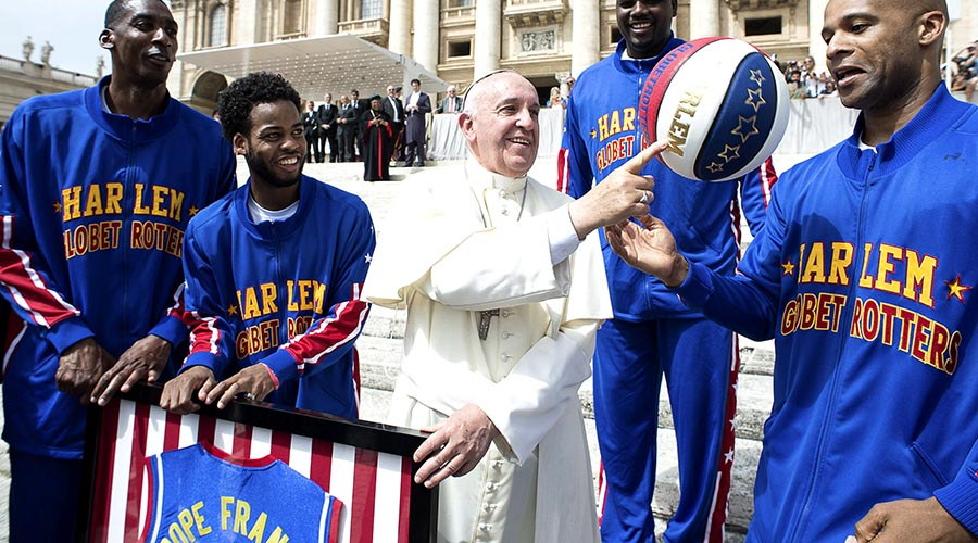 Pope Francis Smiles As He Plays With A Basketball Next To A Member Of The Harlem Globetrotters Basketball Team During The Weekly Audience In Saint Peter's Square At The Vatican